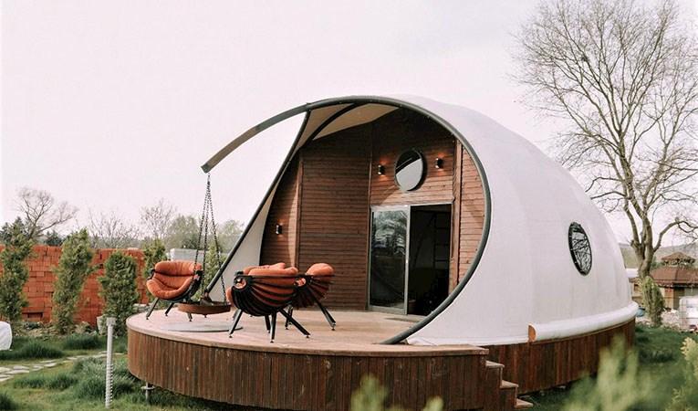 Deniz kabuğu görünümünde minyatür ev